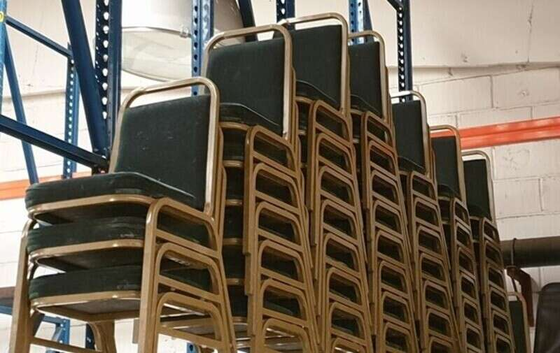 Green stacking chairs