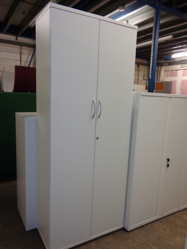Tall white wooden cupboard