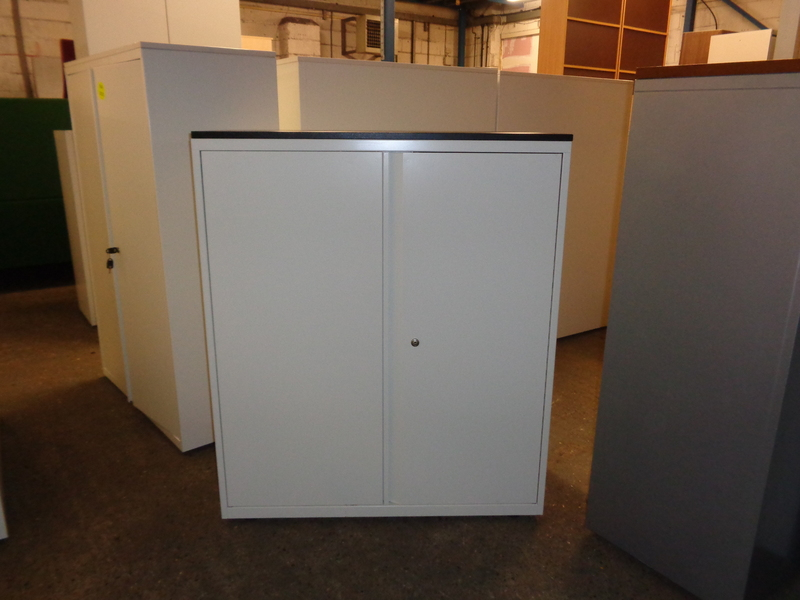 White metal cupboard with black top