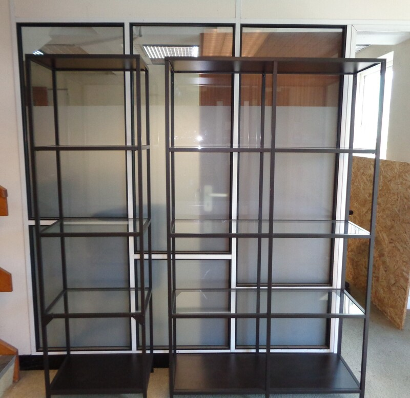 Black metal and glass shelving units