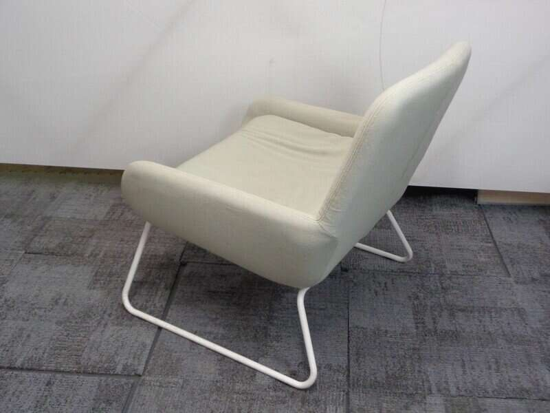 Low pale green armchair