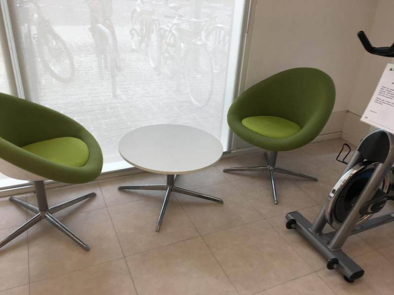 Herman Miller green tub armchairs