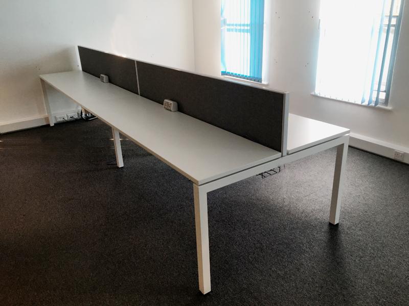 Compact white bench desks per user
