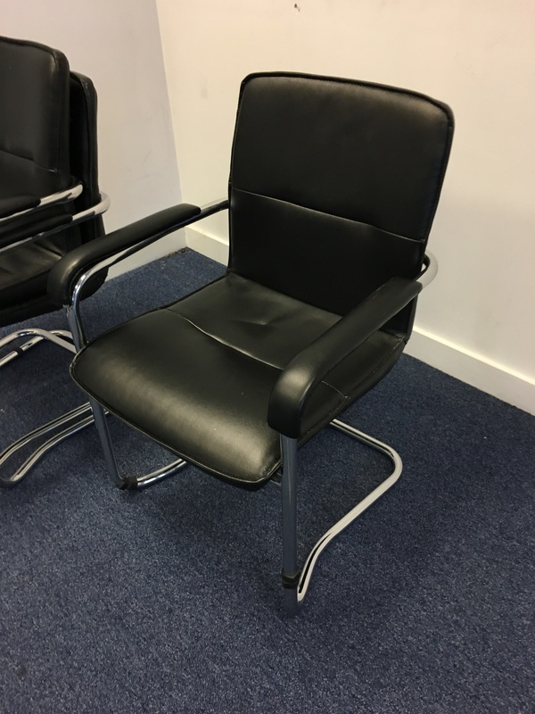 Black leather stacking chairs