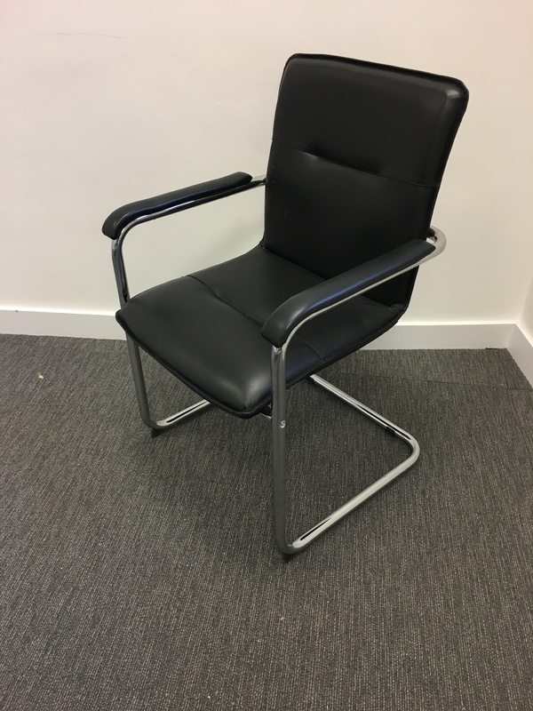 Black and chrome cantilever chairs