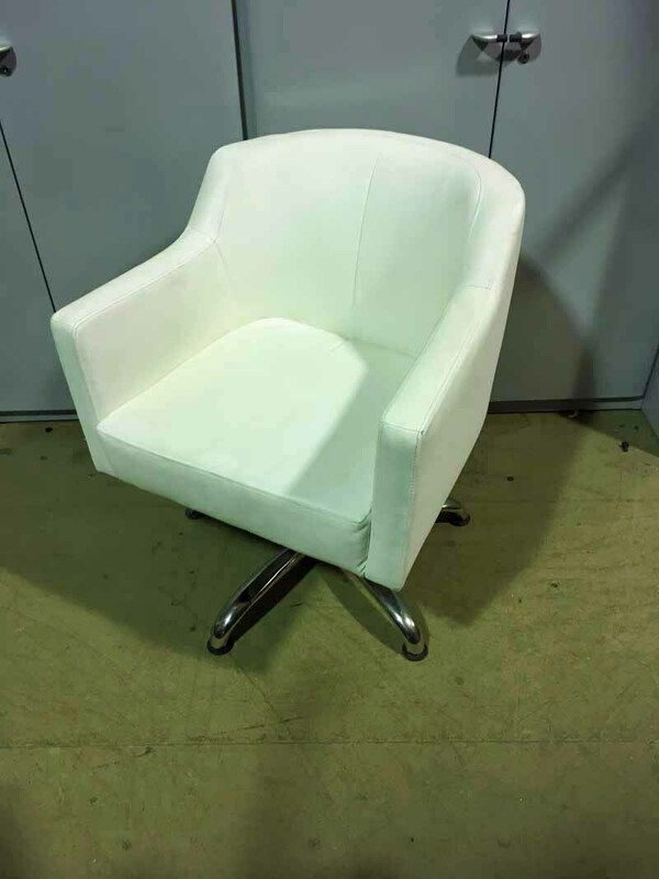 White faux leather swivel armchairs