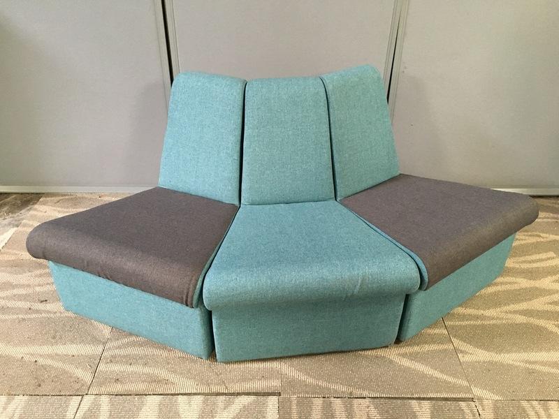 Light blue and grey wedge shape modular seating