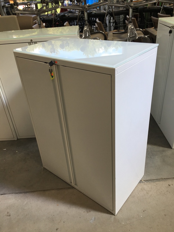 1080mm high white metal cupboards with glass tops