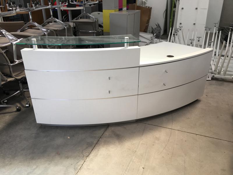 White curved reception desk