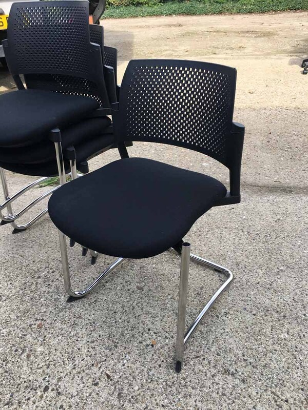 Black Torasen Kyos plastic back stacking chairs