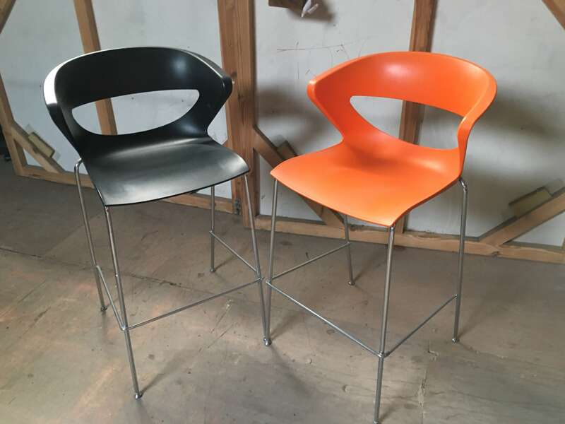 Black and orange plastic stools