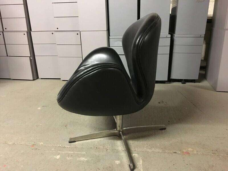 Funky black leather bucket chairs