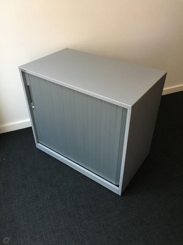 Desk high Triumph silver tambour cupboard