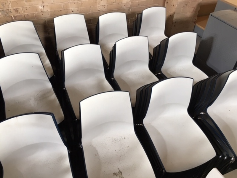 White with blue back plastic stacking chairs
