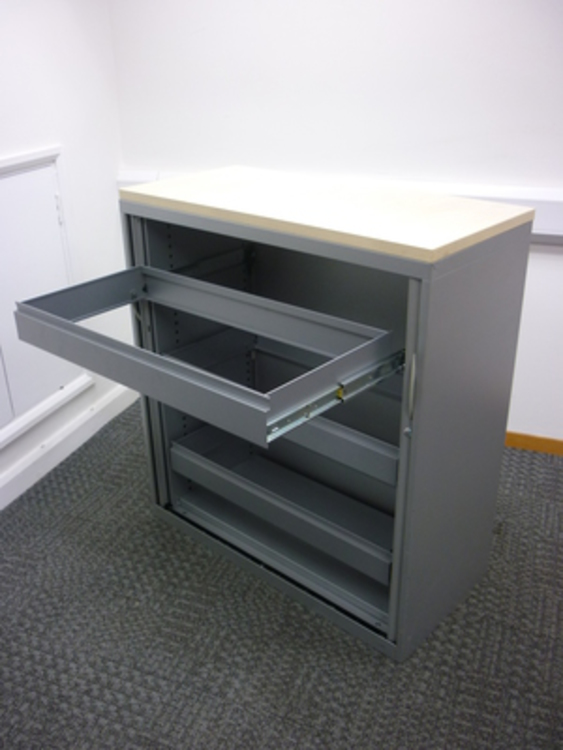 1100mm high Steelcase silver/maple tambour cupboard with rollouts