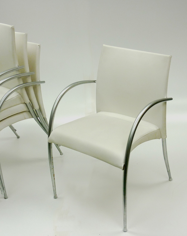 White meeting chairs by Tonon