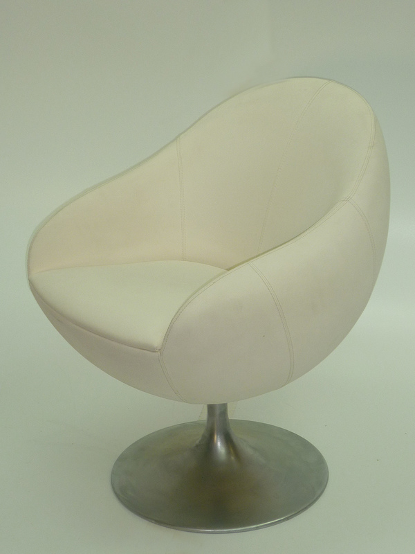 White leather look swivel reception chairs
