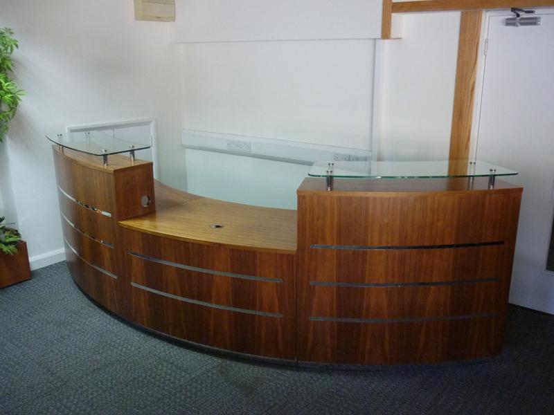 Light walnut curved reception desk