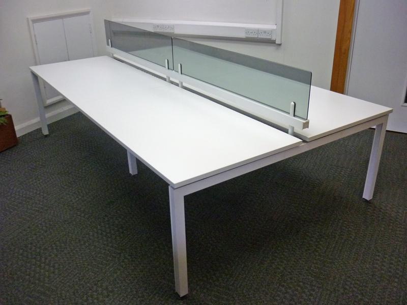 White Herman Miller Sense bench desking with screens