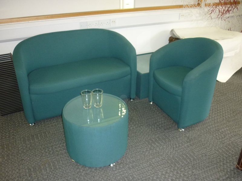 Two seater green tub sofas