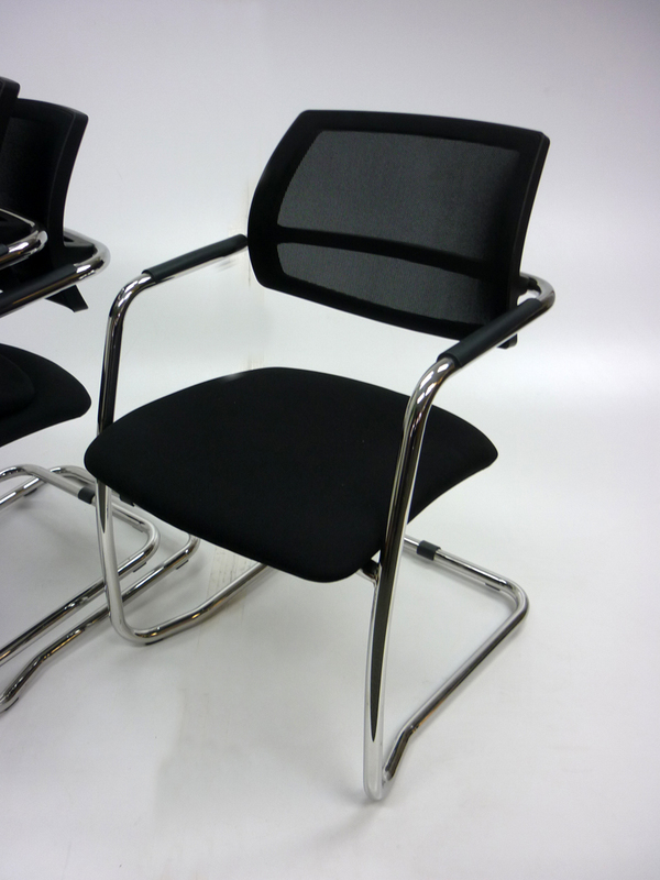 Black mesh back stacking meeting chairs