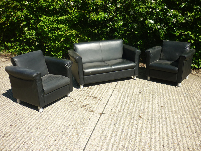 Black leather sofa and armchairs