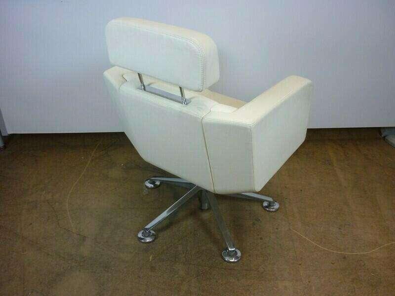 White leather Giroflex Tango armchairs