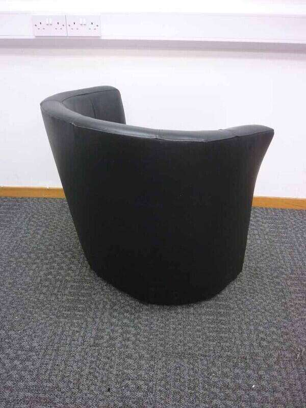 Black faux leather tub chairs