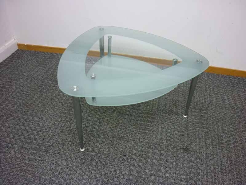 Triangular glass coffee table