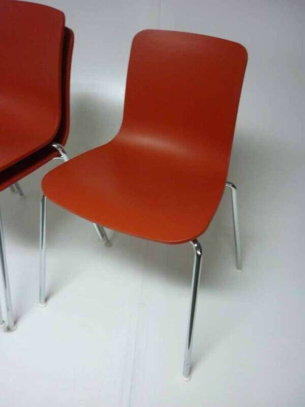 Vitra Hal Tube brick red stacking chairs