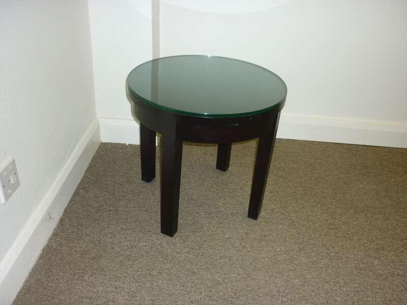 Dark wood circular glass top table