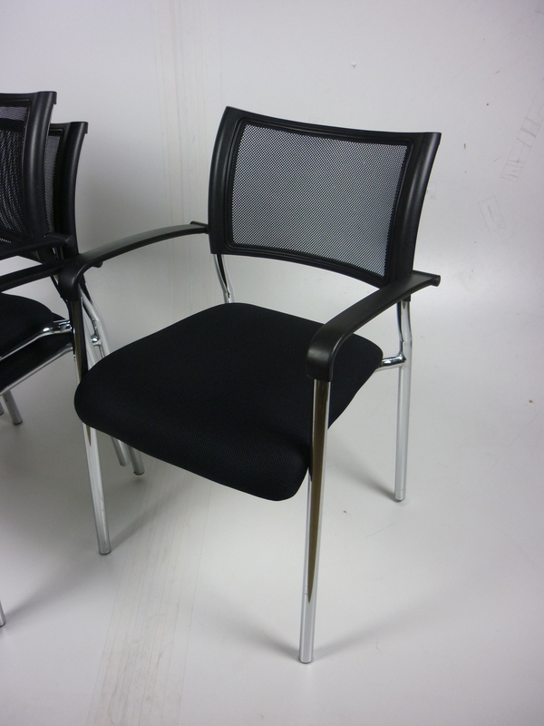 Black mesh back stacking chairs