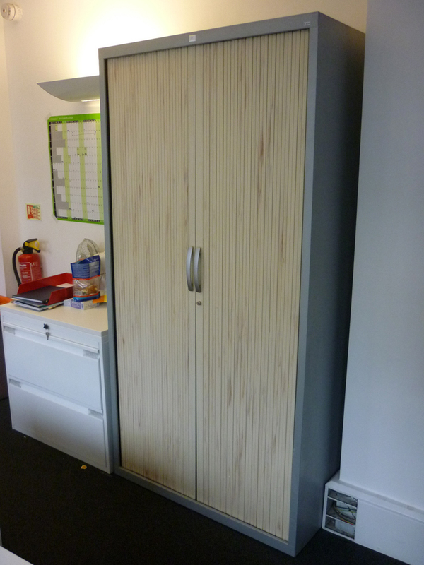 1950mm high JG Group silver/wood tambour cupboard