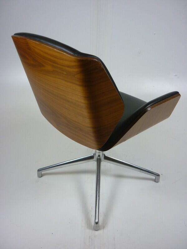 Black leather Boss Design Kruze chairs with walnut back
