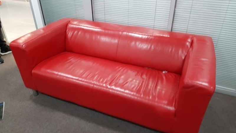 Bright red leather sofa