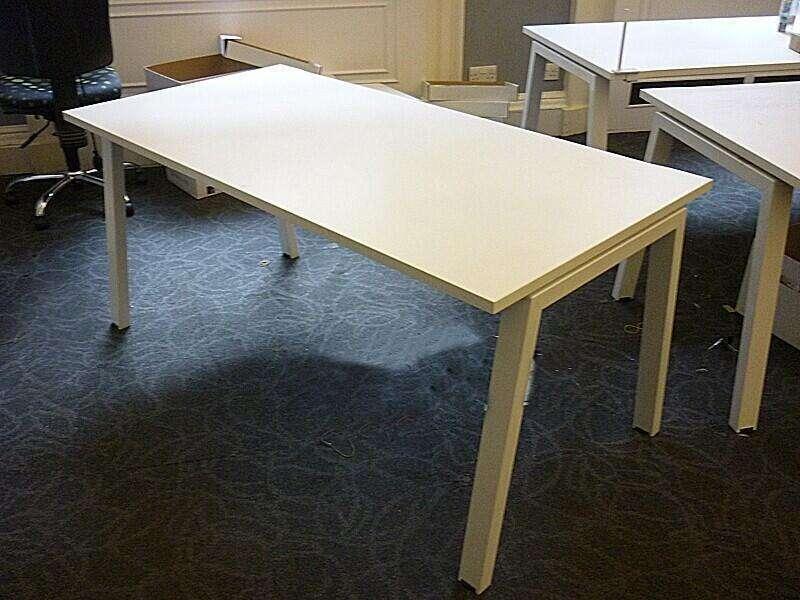 White Elite Linea 1600mm bench desks with silver legs, per person