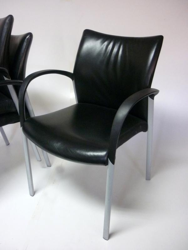 Black leather Senator Trillipse stacking chairs