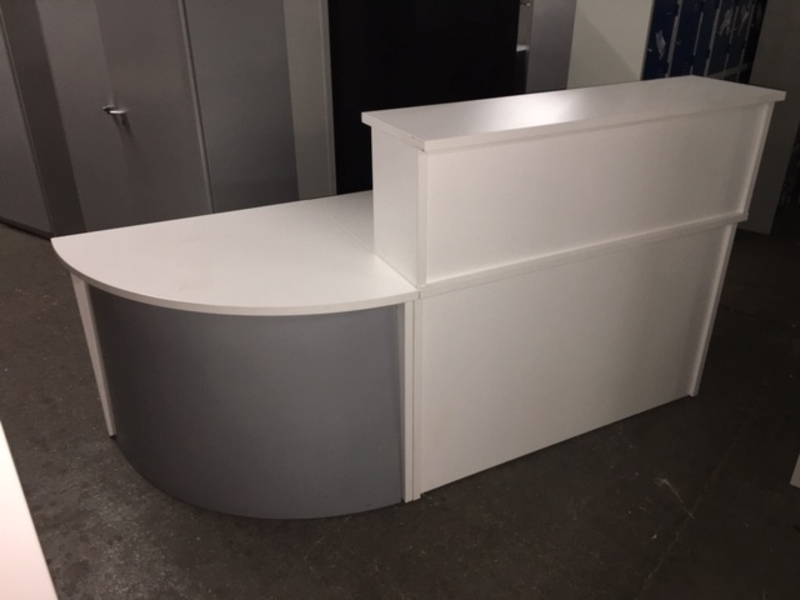 White reception counter with return