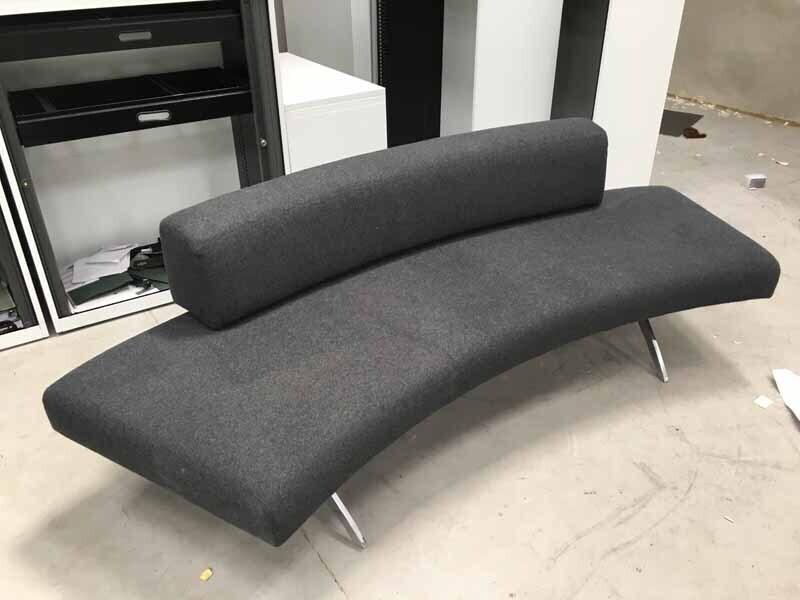 Grey curved sofa