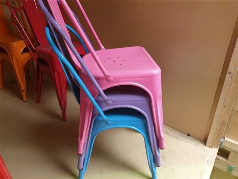 Pink Tolix style metal café chairs