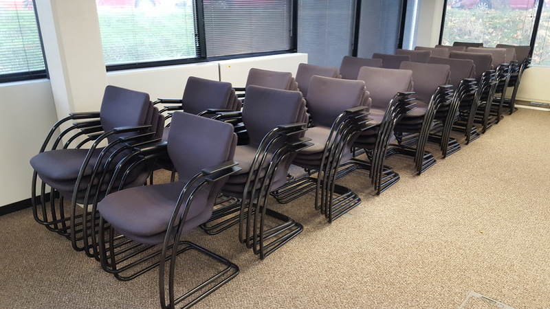 Orangebox X10 black stackable meeting chairs