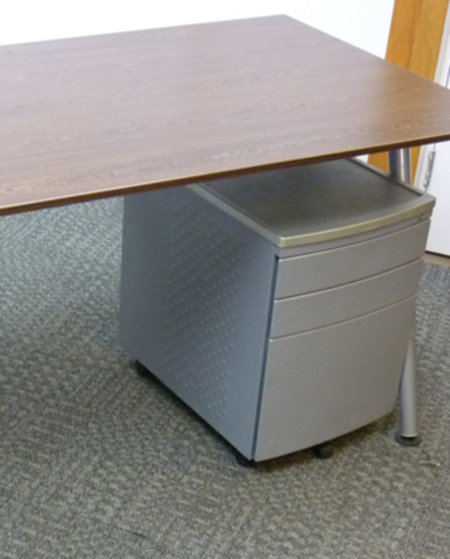 Silver metal desk under pedestals
