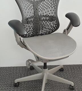 Herman Miller Mirra 1 graphite with grey mesh seat  light grey trim