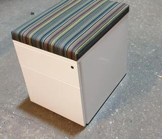 White metal pedestal with striped cushioned top