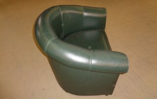 Green faux leather tub chair