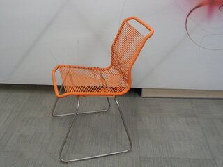 Orange string and metal chair