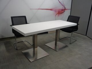 Long chrome and white table