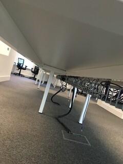 Compact 600mm deep white bench desks per user