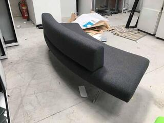 Grey curved sofa