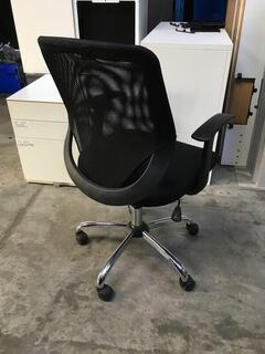 Black mesh back operator chair